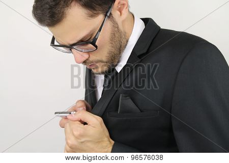 young businessman calling discreetly