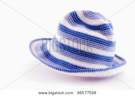 Knitted wool hat isolated on white background.