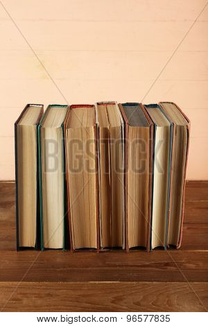Stack of books on wooden background