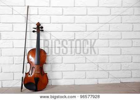 Violin on bricks wall background
