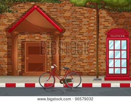 Front view of a house with a telephone boot and bicycle outside