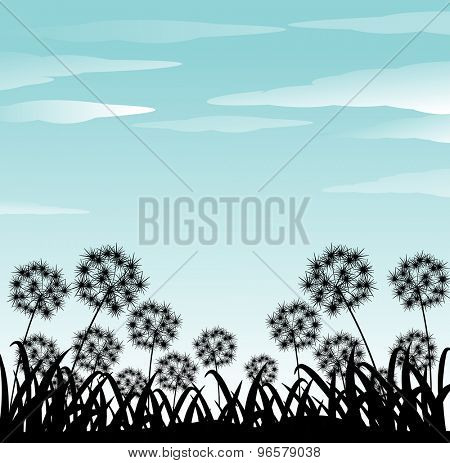Silhouette of flowers and gradd under clear blue sky