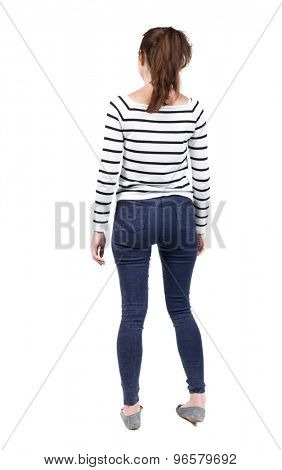 back view of standing young beautiful  woman.  girl  watching. Rear view people collection.    Isolated over white background. French vests and tight pants standing and looking forward.