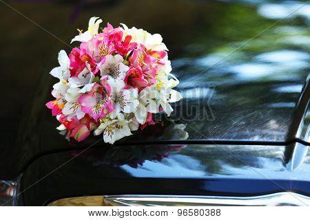 Beautiful flowers on wedding car