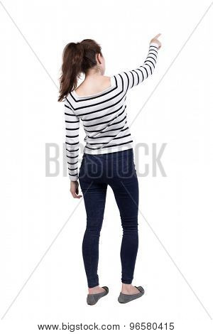 Back view of  pointing woman. beautiful girl. Rear view people collection.  backside view of person.  Isolated over white background. French vests and tight pants showing your right thumb up.