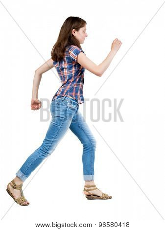 back view running  woman in jeans. beautiful blonde girl in motion. backside view of person.  Isolated over white background. A young girl in a checkered blue with red stripes running waving his arms