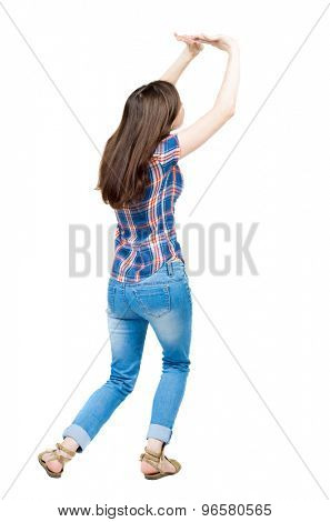 back view of woman  protects hands from what is falling from above.  A young girl in a checkered blue with red stripes frightened covers his head with hands to protect themselves from what is above.