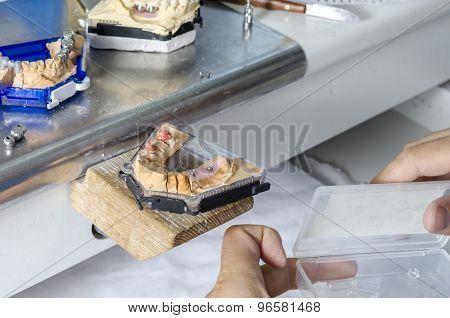 Dental Technician Working With Teeth.
