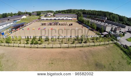 RUSSIA, MOSCOW - JUL 13, 2014: Horsemen formation on arena of equestrian complex Sozidatel during Russian Championship for Dzhigitovka at summer day. Aerial view. Photo with noise from action camera.