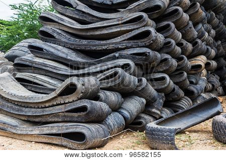 Stack Of Old Wheel Black Tyre.