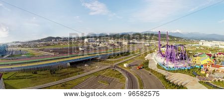 RUSSIA, SOCHI - JUL 27, 2014: Five color pedestrians bridges near Sochi-park. Aerial view. Photo with noise from action camera.