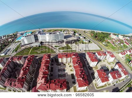 RUSSIA, SOCHI - JUL 30, 2014: Town-hotel Barhatnye Sezony and hotel Radisson Blu on sea shore. Aerial view. Photo with noise from action camera.