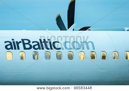 KIEV, UKRAINE - JULY 10, 2015: AirBaltic fuselage airplane in Kiev airport. Air Baltic is the Latvia