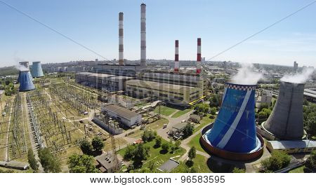 RUSSIA, MOSCOW - JUL 14, 2014: Electric power station in city at sunny summer day. Aerial view. Photo with noise from action camera.