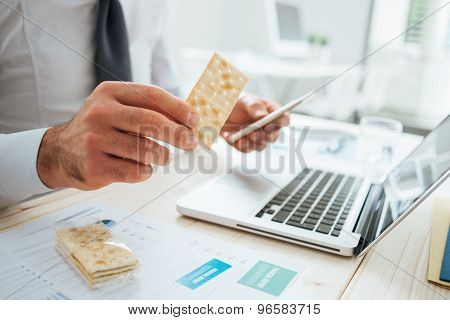 Businessman Eating A Snack