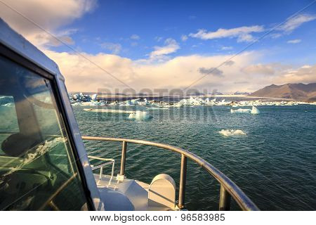 Tour boat in Jokulsarlon Lagoon by the southern coast of Iceland