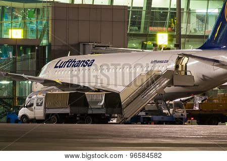 KIEV, UKRAINE - JULY 10, 2015: Lufthansa aircraft stay near terminal of airport and ready for boardi