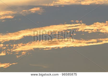 Orange And Yellow Colors Sunset Sky. Sunlight Through Clouds