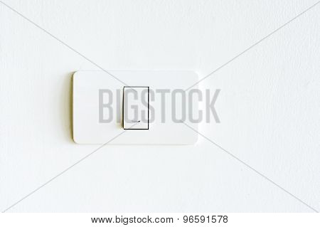 Lighting Switch On White Wall
