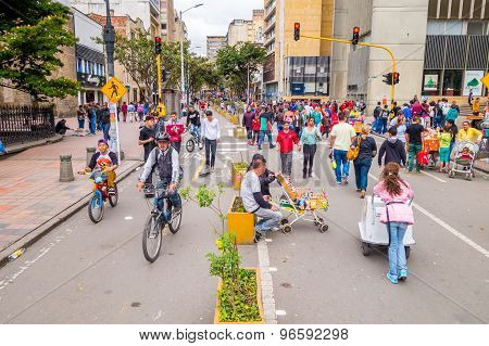 Unidentified hispanic pedestrians, cyclists, dogs and food vendors moving through city center Candel