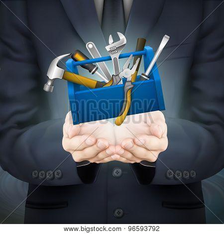 Businessman Holding Tools Box