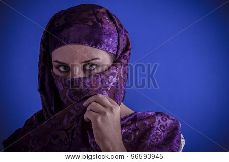 Muslim, Beautiful arabic woman with traditional veil on her face, intense look