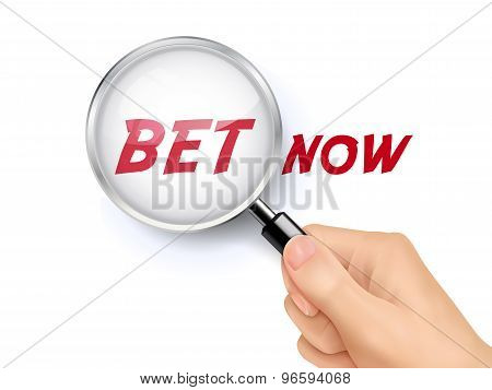 Bet Now Showing Through Magnifying Glass
