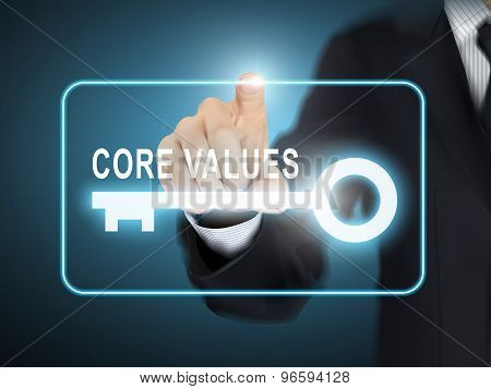 Male Hand Pressing Core Values Key Button