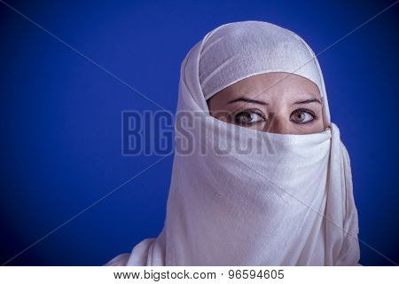 Scarf, Beautiful arabic woman with traditional veil on her face, intense look