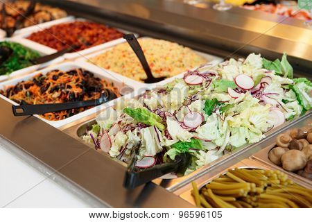Various salads in gastronomical containers, food store or restaurant