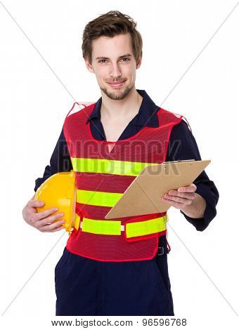 Engineer hold with yellow helmet and clipboard
