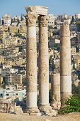stock photo of amman  - View to the ancient stone columns at the Citadel of Amman with the Amman city at the background in Amman - JPG