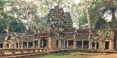 image of raider  - Ta Prohm famouse gate covered with tree roots - JPG