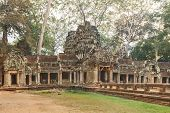 stock photo of raider  - Ta Prohm famouse gate covered with tree roots - JPG