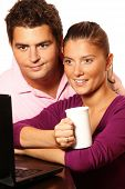 image of married couple  - A picture of a young pretty married couple searching the Internet - JPG