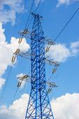 pic of power transmission lines  - Power line tower on blue sky background - JPG