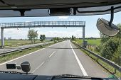 picture of truck-cabin  - View of the highway toll gate of the truck cab - JPG