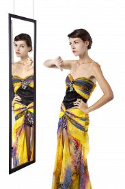 pic of snob  - woman wearing a dress with her thumbs down while looking at a mirror - JPG