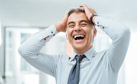 foto of forehead  - Cheerful careless businessman laughing and touching his forehead - JPG