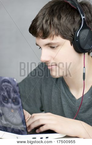 Headphone Wearing Teen Works On Computer