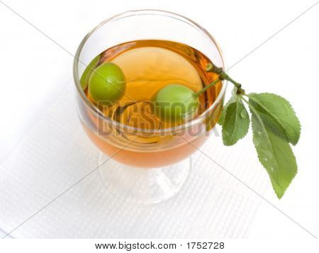 Branch With Plum In A Wine-Glass