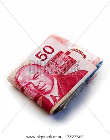 Large fold of Canadian money with the $50 canadian bill on the top