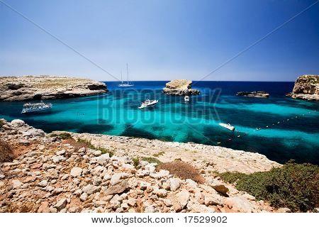 Blug lagoon on a warm summer day on Comino Island, Malta