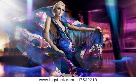 Beautiful woman in gorgeous dress over city background