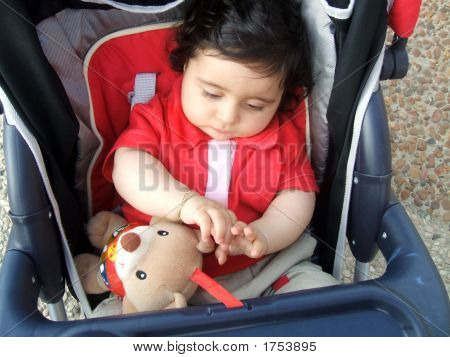 Child Sitting In A Buggy/Pushchair