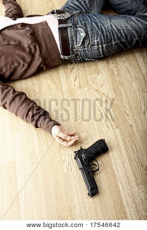 crime scene, dead body on floor and pistol
