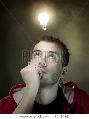 Young Man Having an Idea. Light bulb above his head