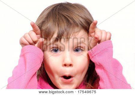 little girl making grimace
