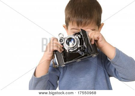 Nice boy shooting with old-fashioned camera