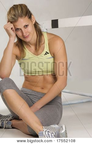 Cute caucasian athletic model with barrier